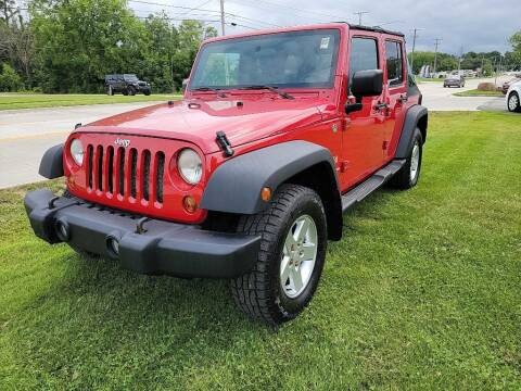 2009 Jeep Wrangler Unlimited for sale at Lakeshore Auto Wholesalers in Amherst OH