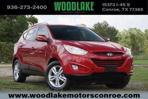 2013 Hyundai Tucson for sale at WOODLAKE MOTORS in Conroe TX