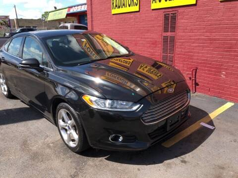 2014 Ford Fusion for sale at 4 Girls Auto Sales in Houston TX