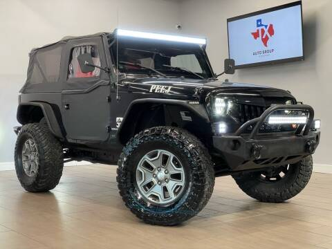 2014 Jeep Wrangler for sale at TX Auto Group in Houston TX