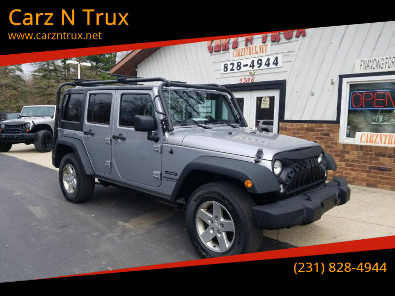 2014 Jeep Wrangler Unlimited for sale at Carz N Trux in Twin Lake MI