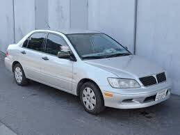 2002 Mitsubishi Lancer for sale at TROPICAL MOTOR SALES in Cocoa FL