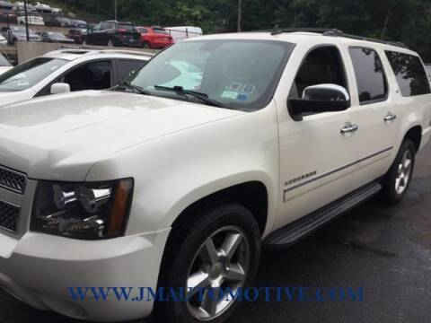 2014 Chevrolet Suburban for sale at J & M Automotive in Naugatuck CT