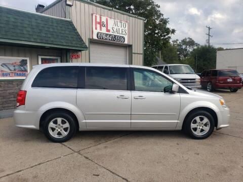 2012 Dodge Grand Caravan for sale at H & L AUTO SALES LLC in Wyoming MI