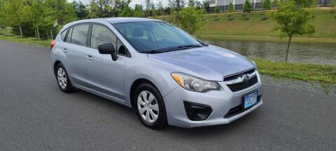 2014 Subaru Impreza for sale at BOOST MOTORS LLC in Sterling VA