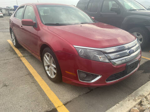 2012 Ford Fusion for sale at BELOW BOOK AUTO SALES in Idaho Falls ID