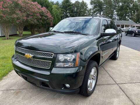 2013 Chevrolet Avalanche for sale at Getsinger's Used Cars in Anderson SC