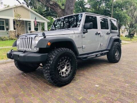 2014 Jeep Wrangler Unlimited for sale at CHECK  AUTO INC. in Tampa FL