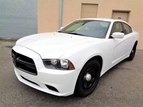 2014 Dodge Charger for sale at Selective Motor Cars in Miami FL
