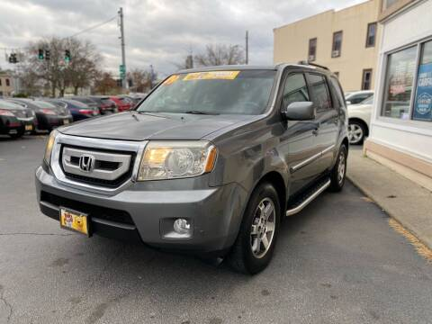 2009 Honda Pilot for sale at ADAM AUTO AGENCY in Rensselaer NY
