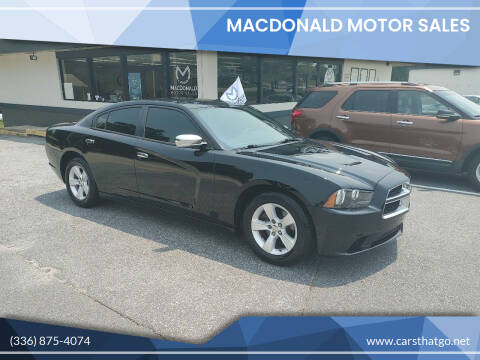 2014 Dodge Charger for sale at MacDonald Motor Sales in High Point NC