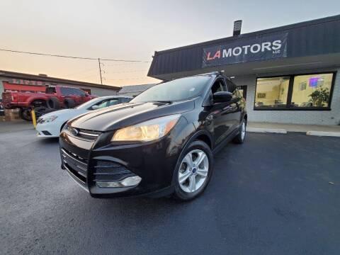 2015 Ford Escape for sale at LA Motors LLC in Denver CO