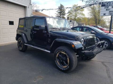 2014 Jeep Wrangler Unlimited for sale at The Car Mart in Milford IN