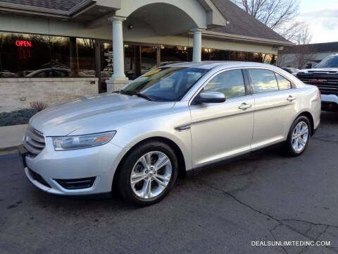 2014 Ford Taurus for sale at DEALS UNLIMITED INC in Portage MI