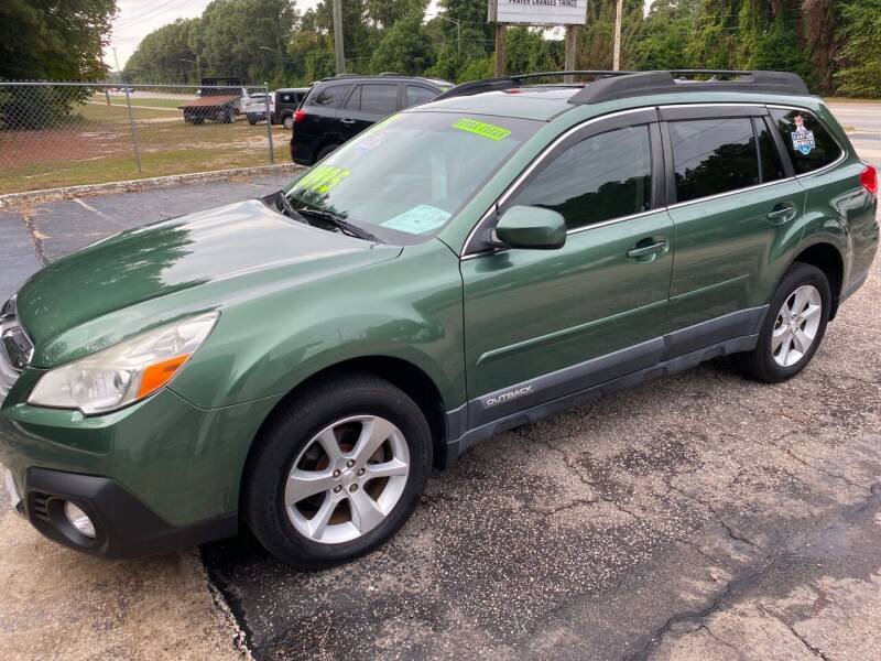 2013 Subaru Outback for sale at TOP OF THE LINE AUTO SALES in Fayetteville NC