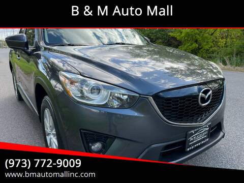 2014 Mazda CX-5 for sale at B & M Auto Mall in Clifton NJ