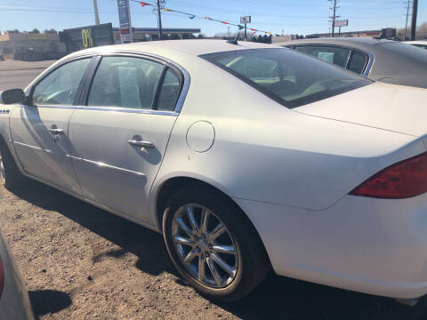2006 Buick Lucerne for sale at BARNES AUTO SALES in Mandan ND