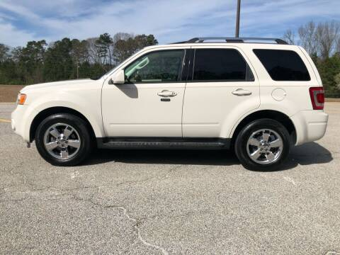 2009 Ford Escape for sale at WIGGLES AUTO SALES INC in Mableton GA