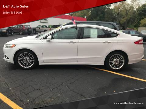 2015 Ford Fusion for sale at L&T Auto Sales in Three Rivers MI