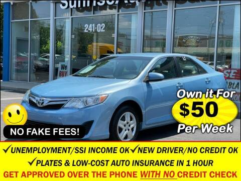 2014 Toyota Camry for sale at AUTOFYND in Elmont NY