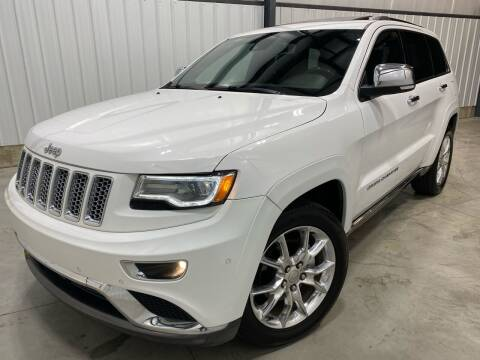 2014 Jeep Grand Cherokee for sale at EUROPEAN AUTOHAUS, LLC in Holland MI