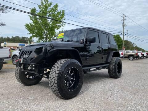 2014 Jeep Wrangler Unlimited for sale at 216 Auto Sales in Mc Calla AL