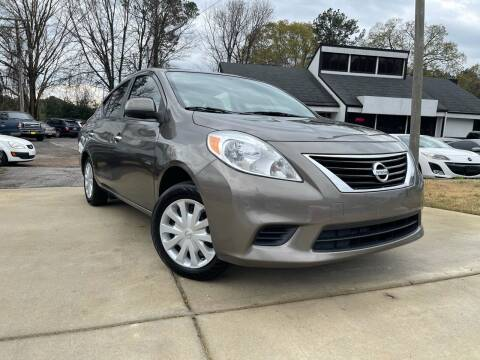2014 Nissan Versa for sale at Alpha Car Land LLC in Snellville GA