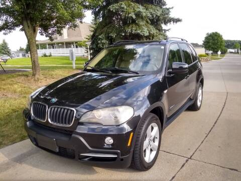 2009 BMW X5 for sale at Heartbeat Used Cars & Trucks in Harrison Twp MI