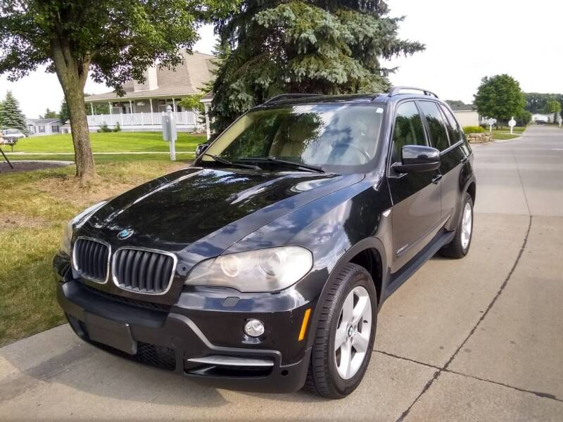 2009 BMW X5 for sale at Heartbeat Used Cars & Trucks in Harrison Township MI