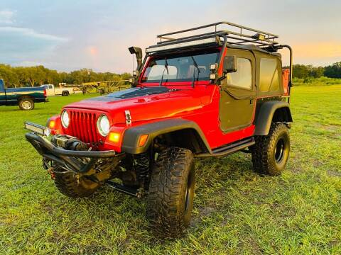 1999 Jeep Wrangler for sale at CHECK  AUTO INC. in Tampa FL