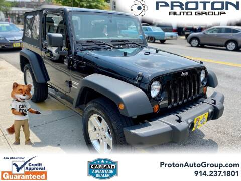 2013 Jeep Wrangler for sale at Proton Auto Group in Yonkers NY