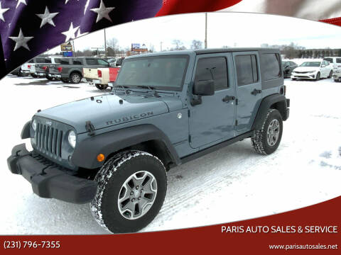 2015 Jeep Wrangler Unlimited for sale at Paris Auto Sales & Service in Big Rapids MI