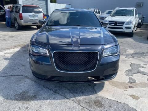 2015 Chrysler 300 for sale at America Auto Wholesale Inc in Miami FL