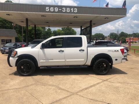 2012 Nissan Titan for sale at BOB SMITH AUTO SALES in Mineola TX