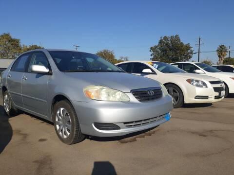 2007 Toyota Corolla for sale at COMMUNITY AUTO in Fresno CA