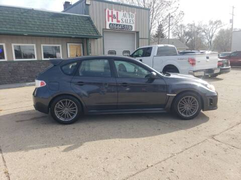 2013 Subaru Impreza for sale at H & L AUTO SALES LLC in Wyoming MI