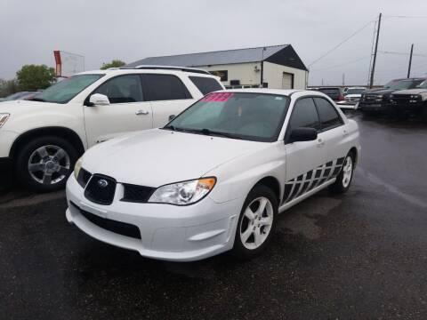 2007 Subaru Impreza for sale at BELOW BOOK AUTO SALES in Idaho Falls ID