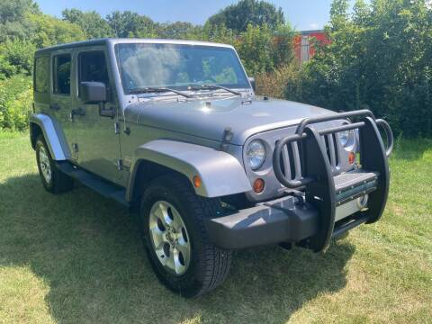 2013 Jeep Wrangler Unlimited for sale at M & M Motors in West Allis WI