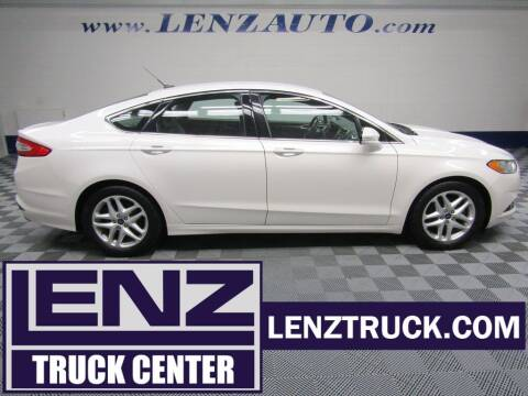 2015 Ford Fusion for sale at LENZ TRUCK CENTER in Fond Du Lac WI