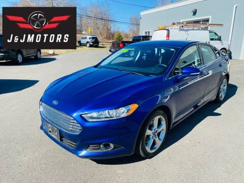 2014 Ford Fusion for sale at J & J MOTORS in New Milford CT