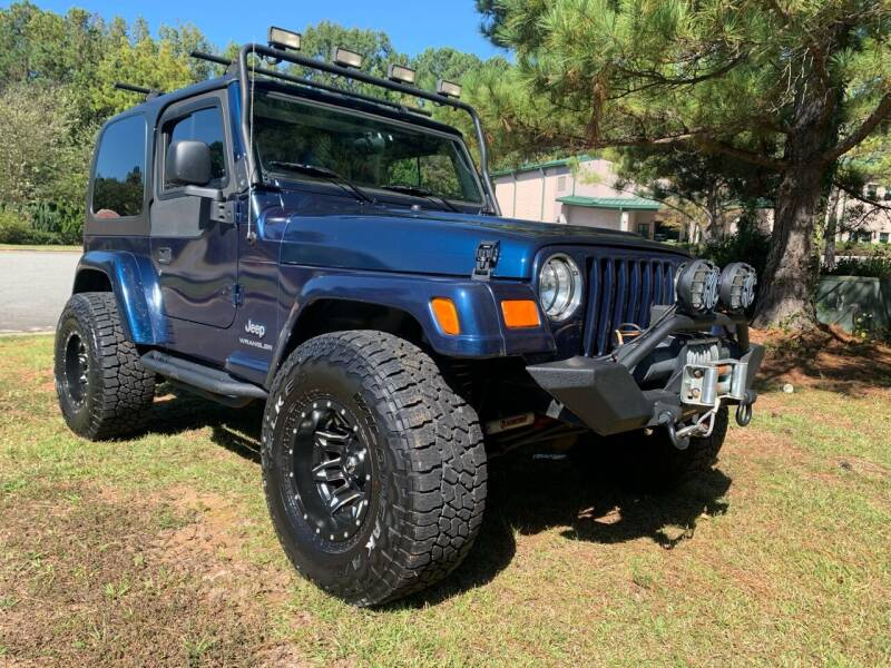 2005 Jeep Wrangler for sale at Triangle Motors Inc in Raleigh NC