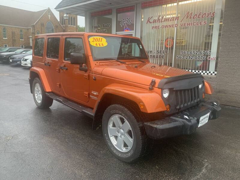 2011 Jeep Wrangler Unlimited for sale at KUHLMAN MOTORS in Maquoketa IA