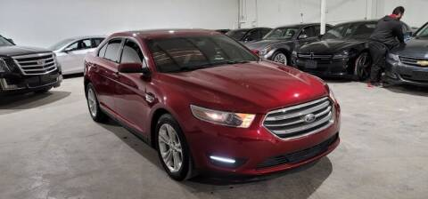2014 Ford Taurus for sale at A & J Enterprises in Dallas TX