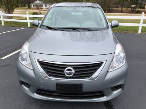 2014 Nissan Versa for sale at Global Autos in Kenly NC