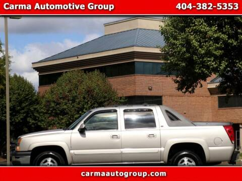 2005 Chevrolet Avalanche for sale at Carma Auto Group in Duluth GA