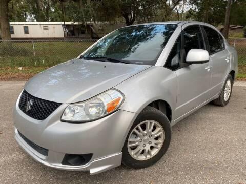 2013 Suzuki SX4 for sale at Next Autogas Auto Sales in Jacksonville FL