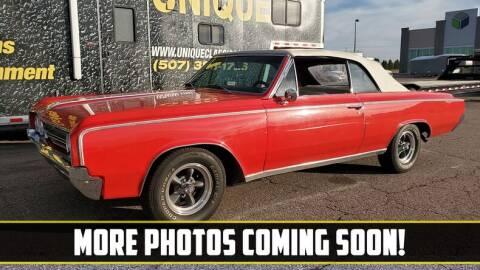 1964 Oldsmobile Cutlass for sale at UNIQUE SPECIALTY & CLASSICS in Mankato MN