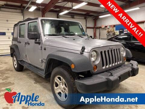 2013 Jeep Wrangler Unlimited for sale at APPLE HONDA in Riverhead NY