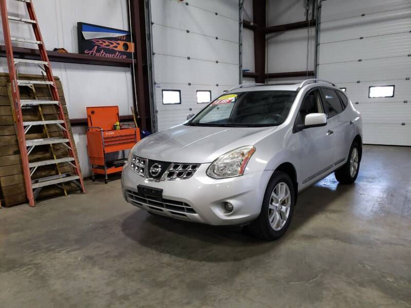 2011 Nissan Rogue for sale at Hometown Automotive Service & Sales in Holliston MA