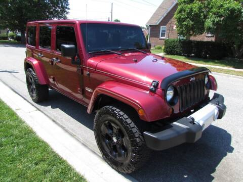2013 Jeep Wrangler Unlimited for sale at First Choice Automobile in Uniondale NY